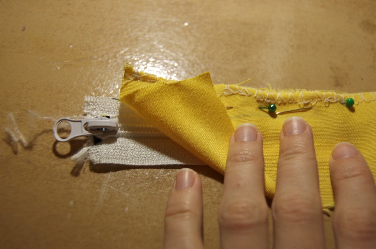Sew the Zipper to the Narrower Piece