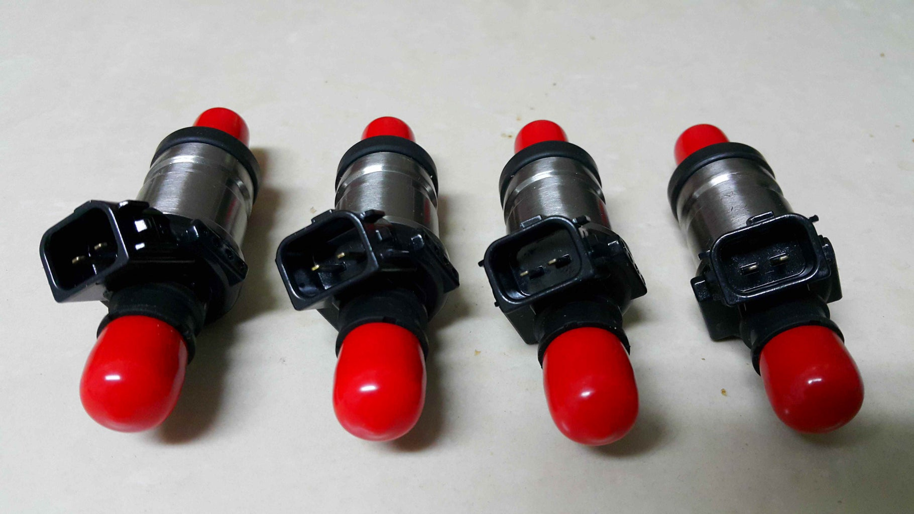Comparing the OEM and New Injectors.