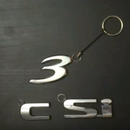 Make a Keychain From a Car Badge With JB Weld