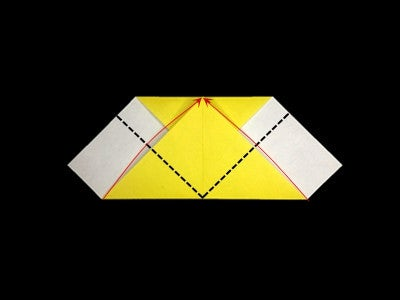 Fold Both the Bottom Corners to the Center Point of the Upper Edge Along the Dotted Lines.
