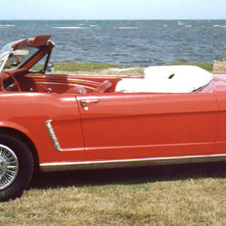 a_1964_Ford_Mustang_4-Speed_Convertible.png