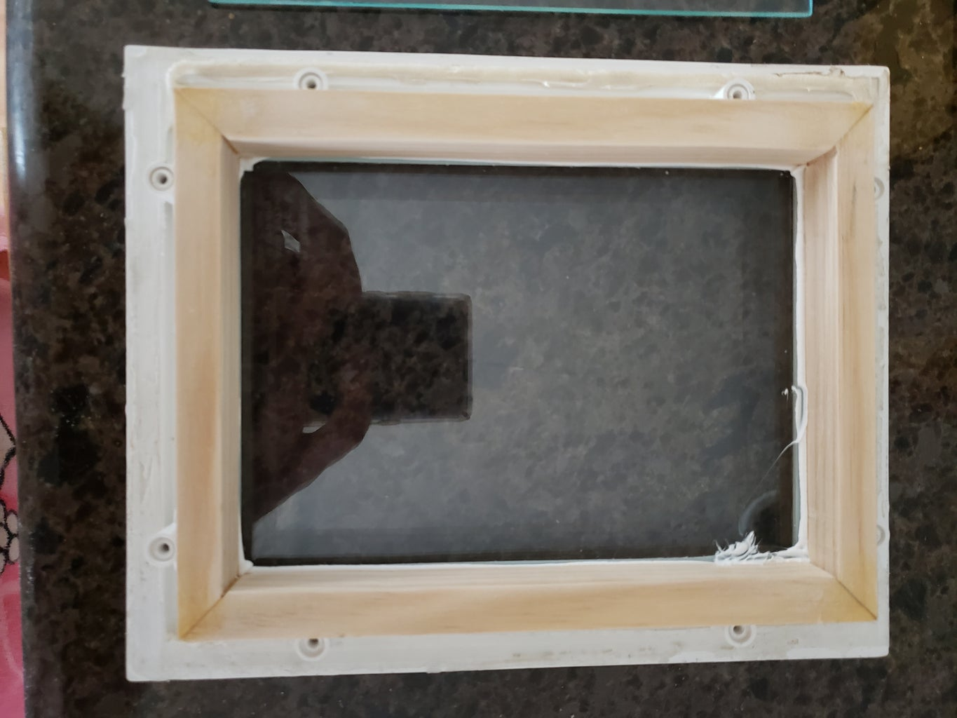 Wooden Frame to Support the Glass.