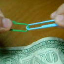 How to connect 2 paperclips with 1 dollar