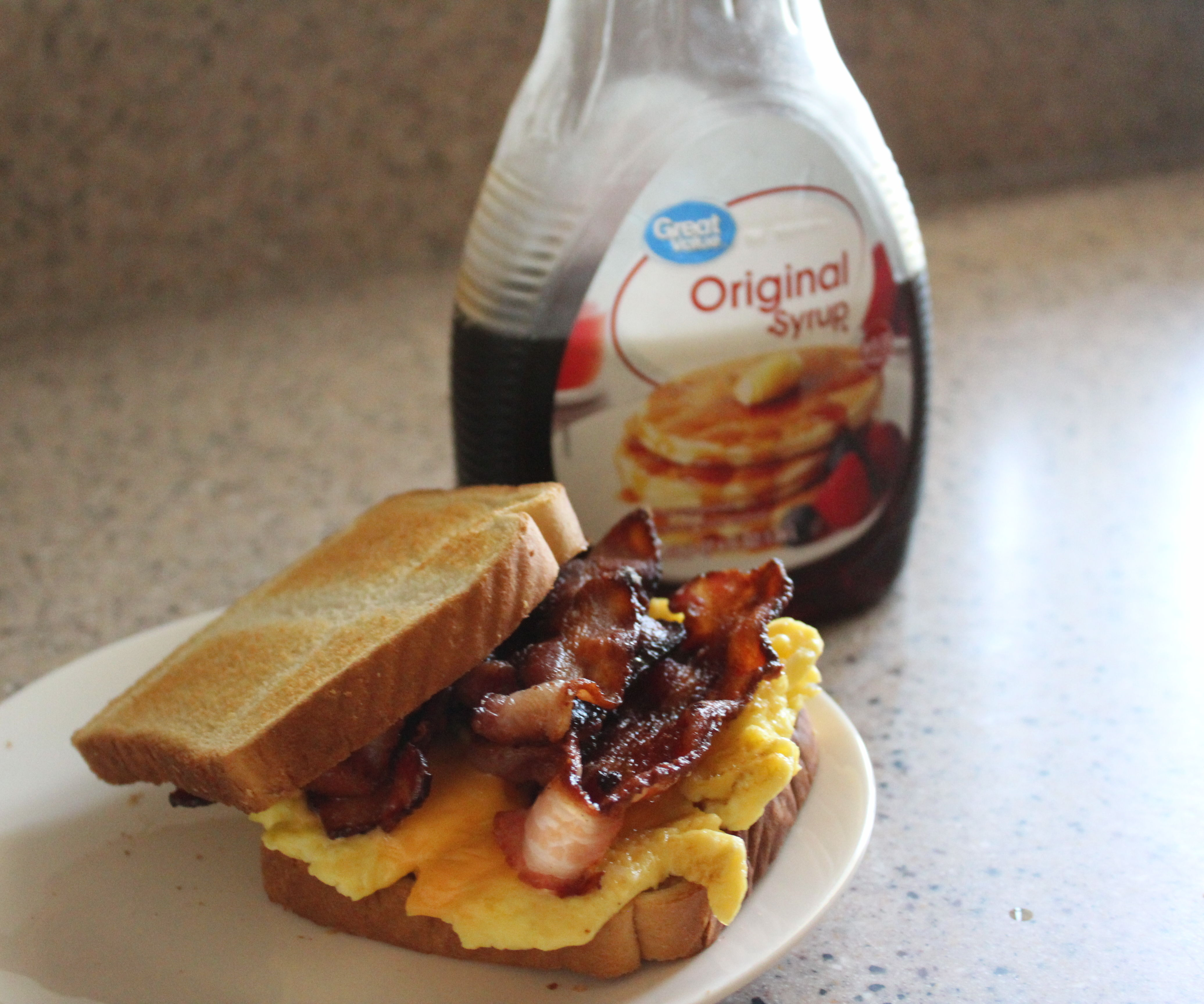 Bacon,Egg,Cheese Sandwich Drizzled With Syrup