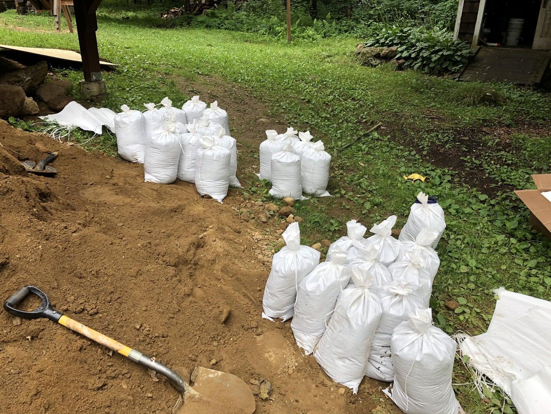 Filling Sandbags for the Walls