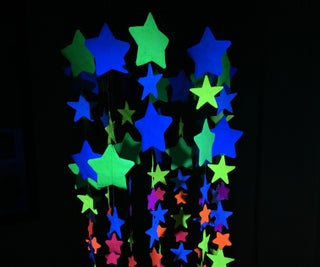 Make a Music Playing Mobile With Glowing Multi-Colored Paper Stars!