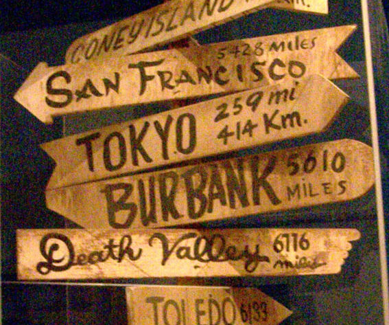 MASH-style city directional sign