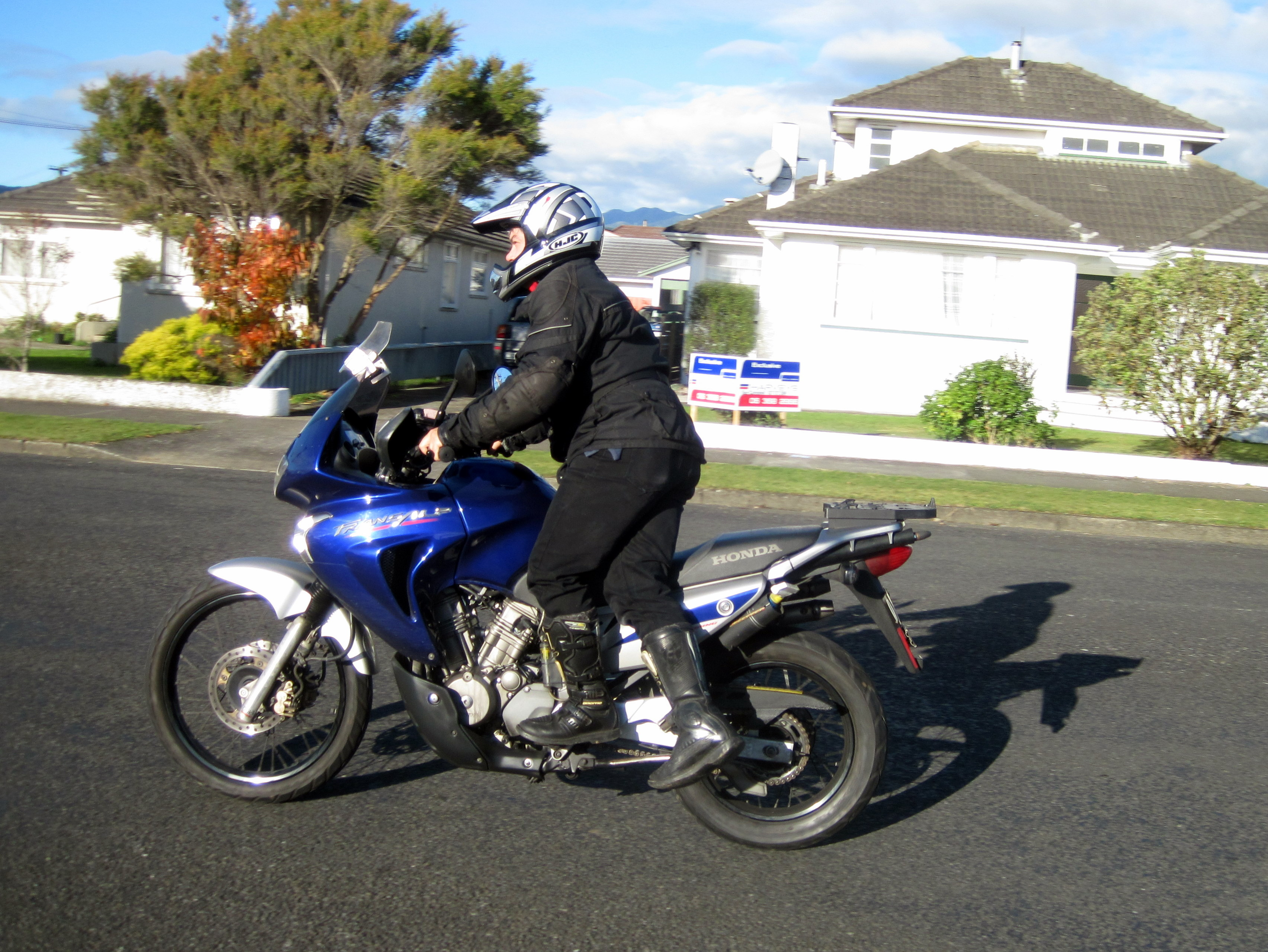 How to ride a tall motorbike if you are short.