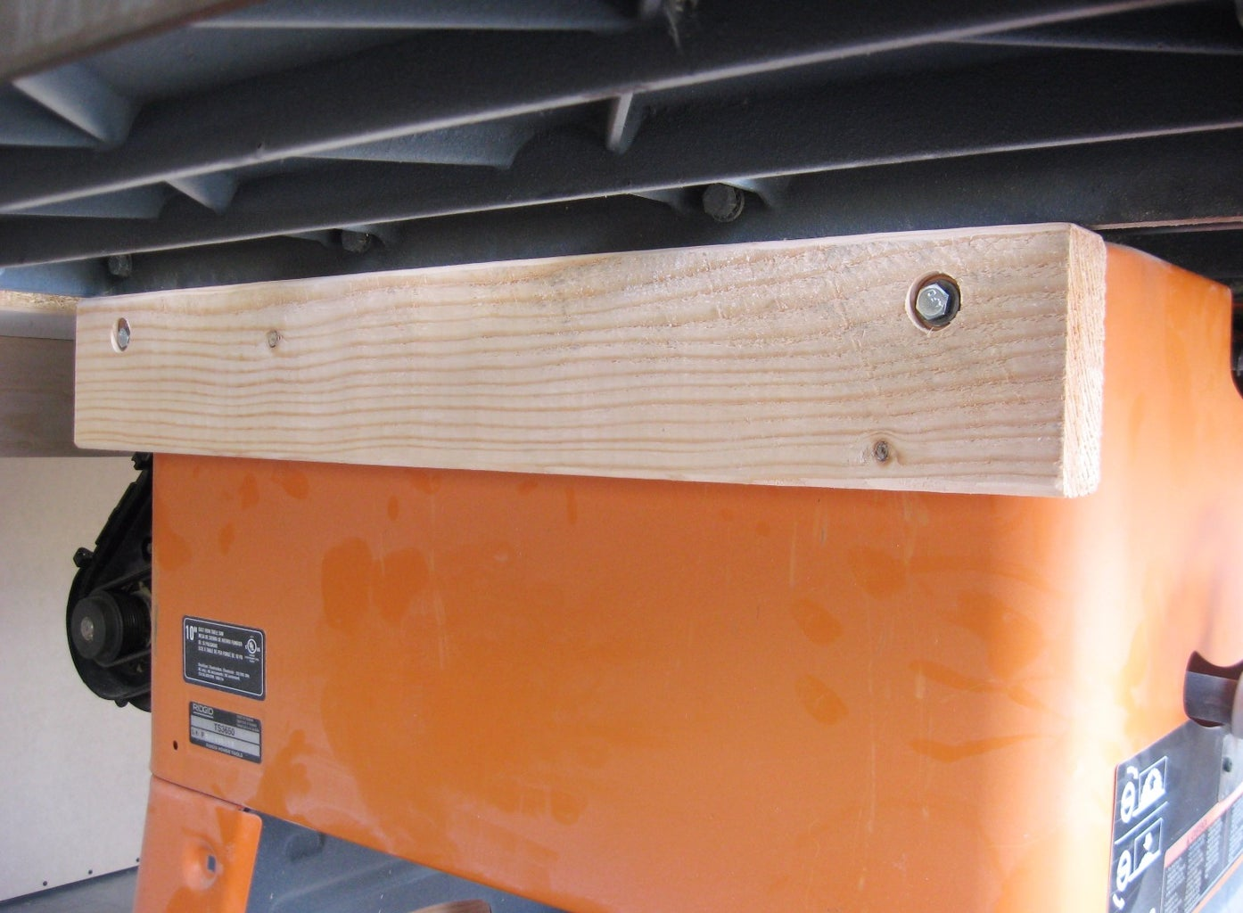 Fasten Saw to Outfeed Table