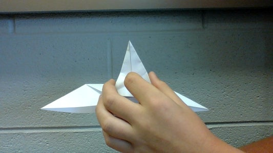 Push Down in the Center of Your Soon to Be Beak, and Fold the Two Sides Together, Then Push Down