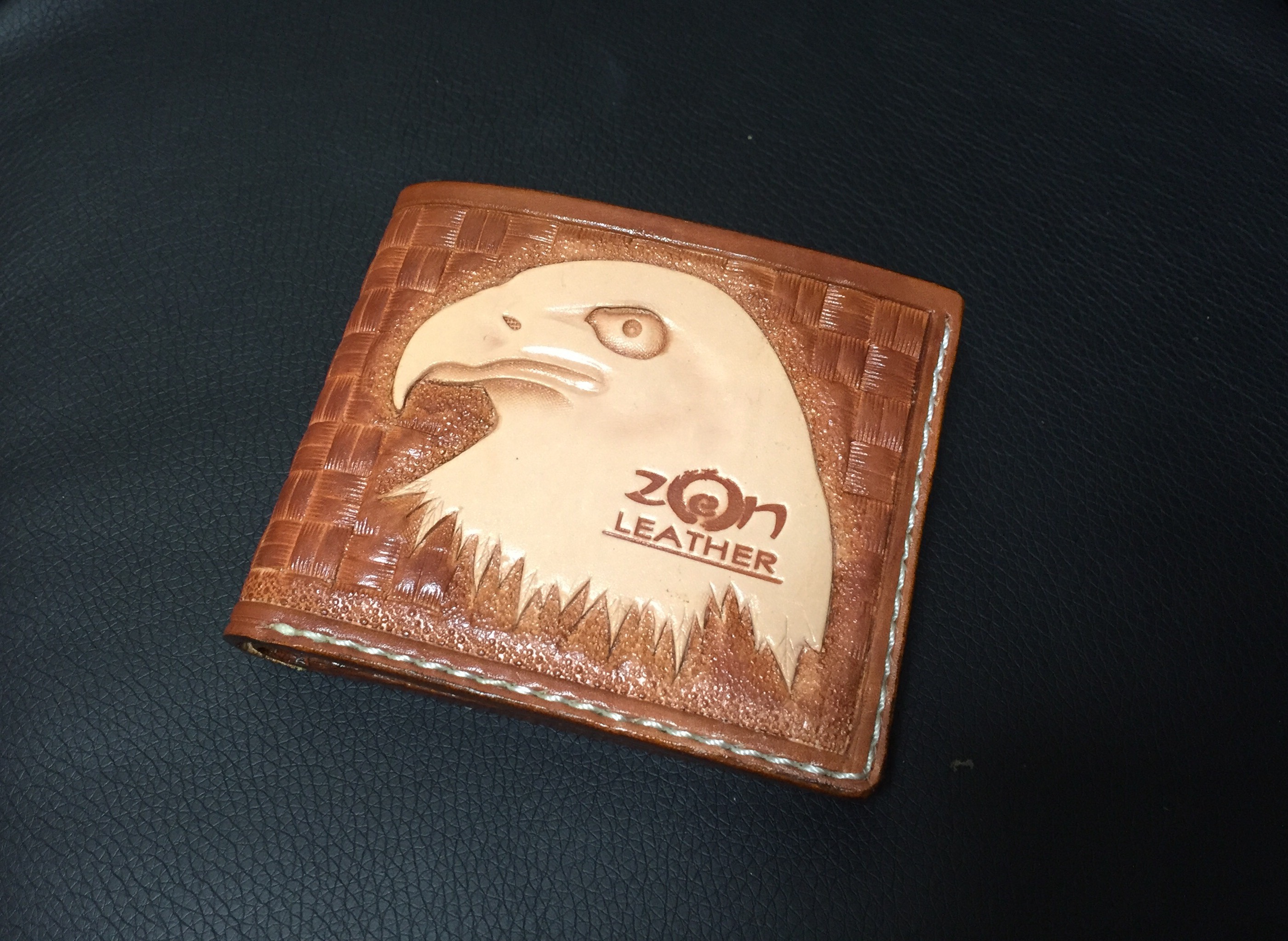 Carved leather wallet