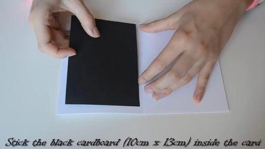Stick the Black Cardboard Inside the Card.