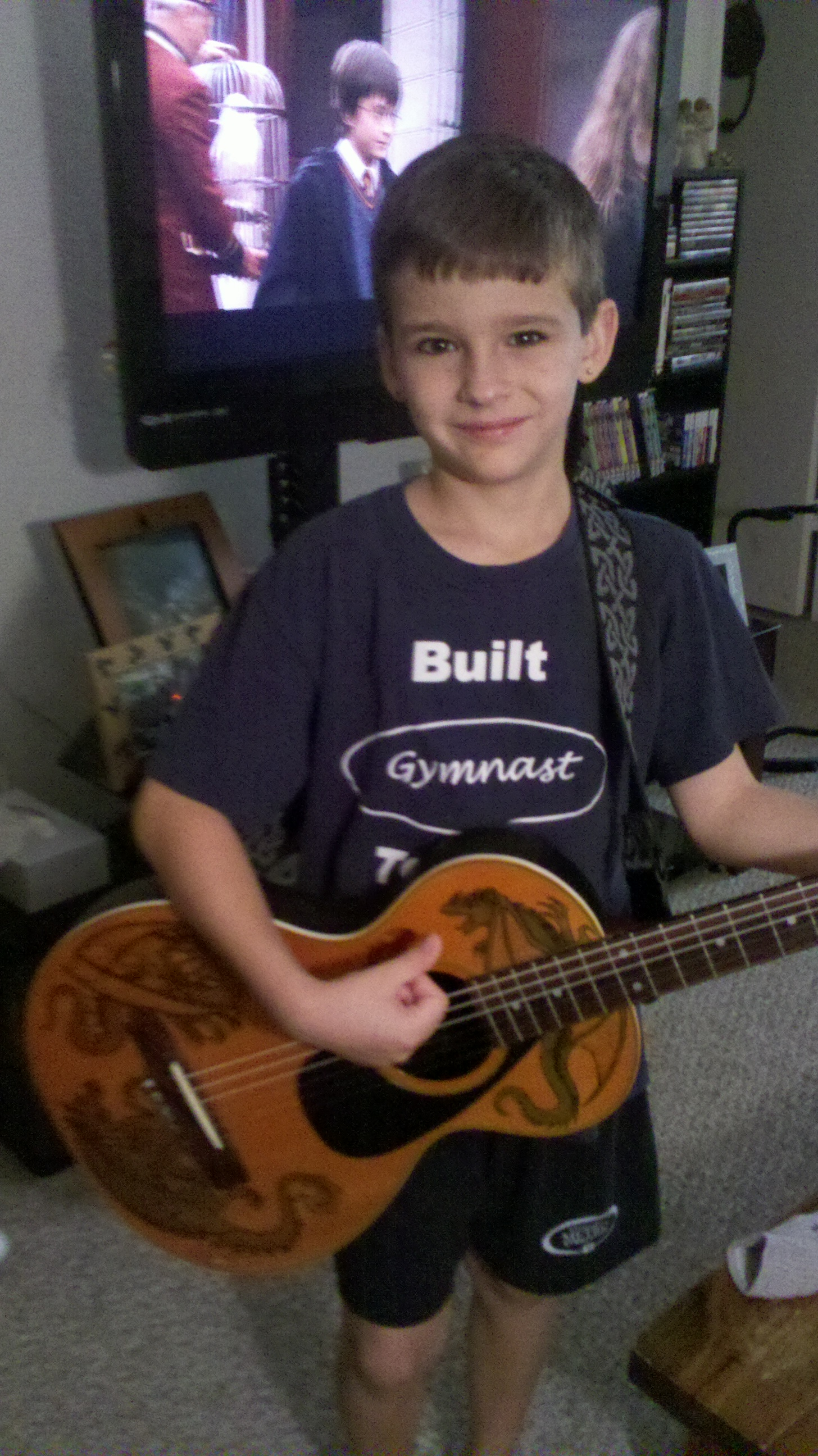 Personalizing a guitar, using waterslides. (or, how to turn a free acoustic guitar in to something you can feel proud to jam with)