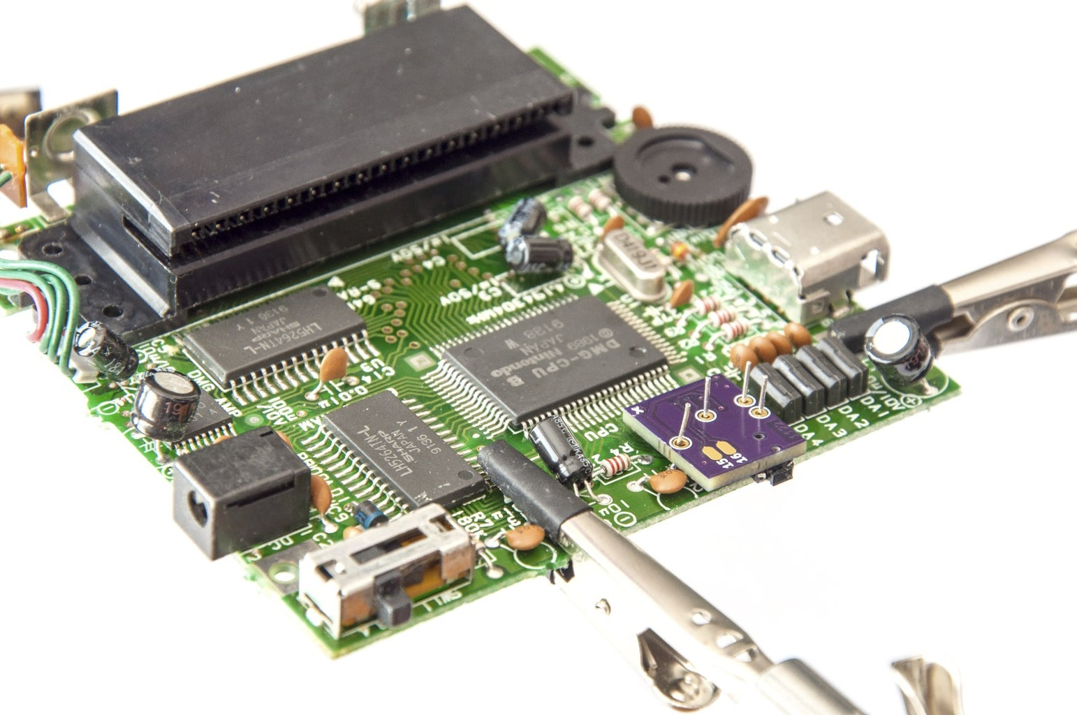 Position and Solder the Bi-vert Chip to the Extended Leads on the DMG Mainboard (CPU Side)