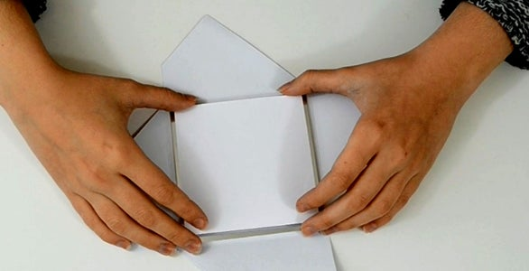 Stick the Silver and the White Squares on the Card.