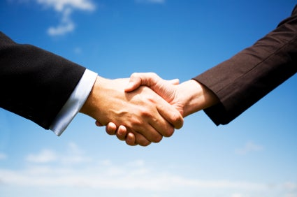 Do: Introduce Yourself With a Firm Handshake