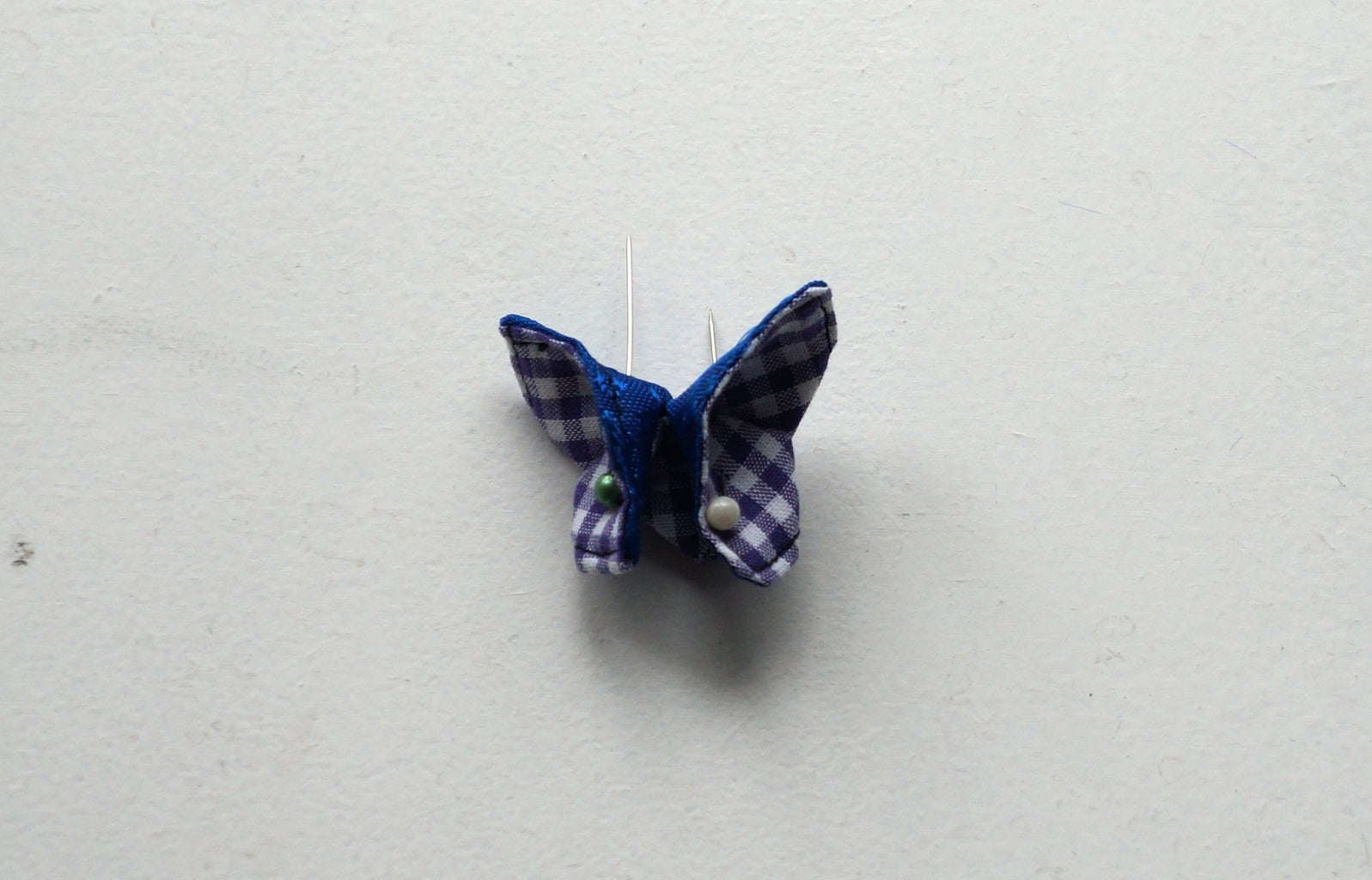 Fold Into Butterfly and Attach to Pin