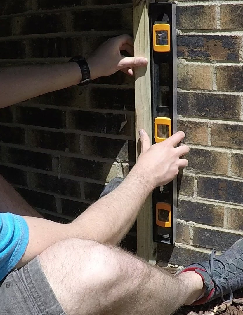 Install Posts Against Brick Wall