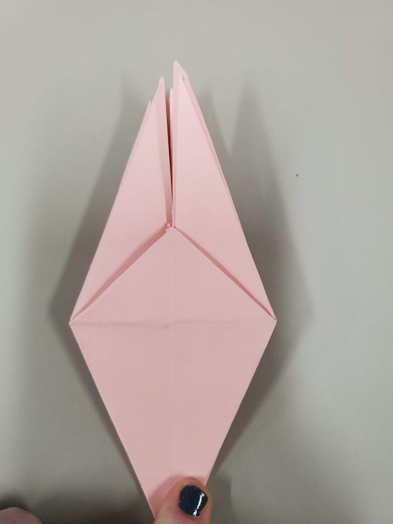 Squash the Three Other Pockets and Fold the Little Flaps Up