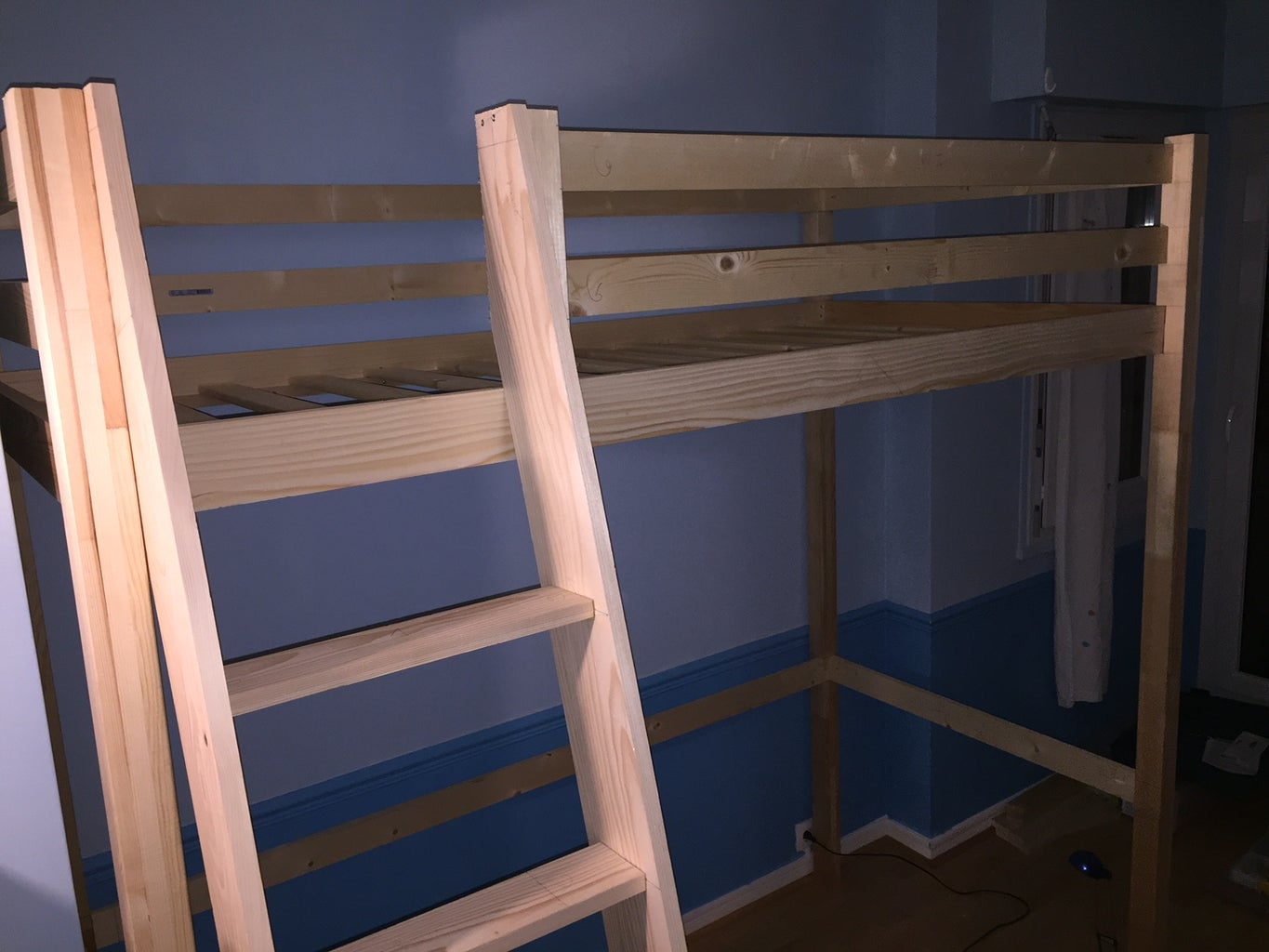Mezzanine Bed With Frame Inserted Into Posts