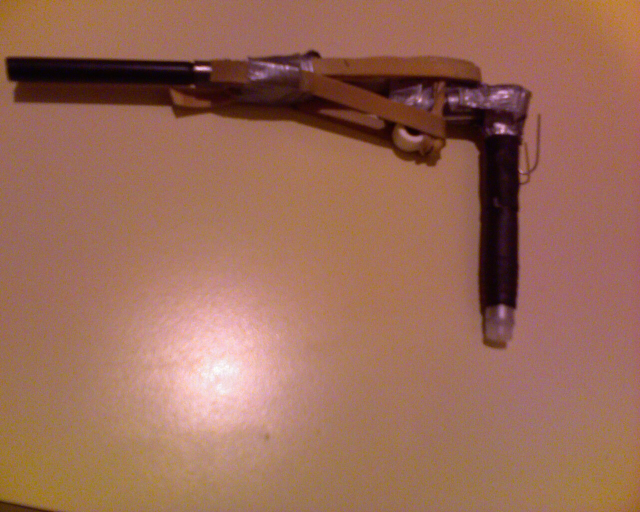 Pen pistol with trigger