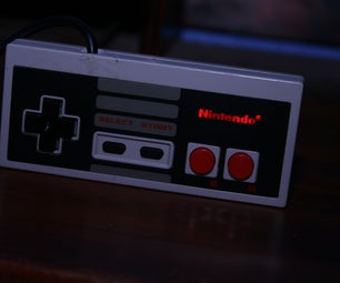 Nes Controller With Leds Lighting Up the Logo