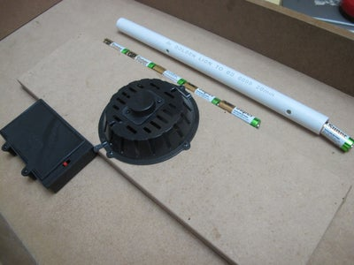 Get a PVC Pipe, Piece of Paper and Some Hot Glue.
