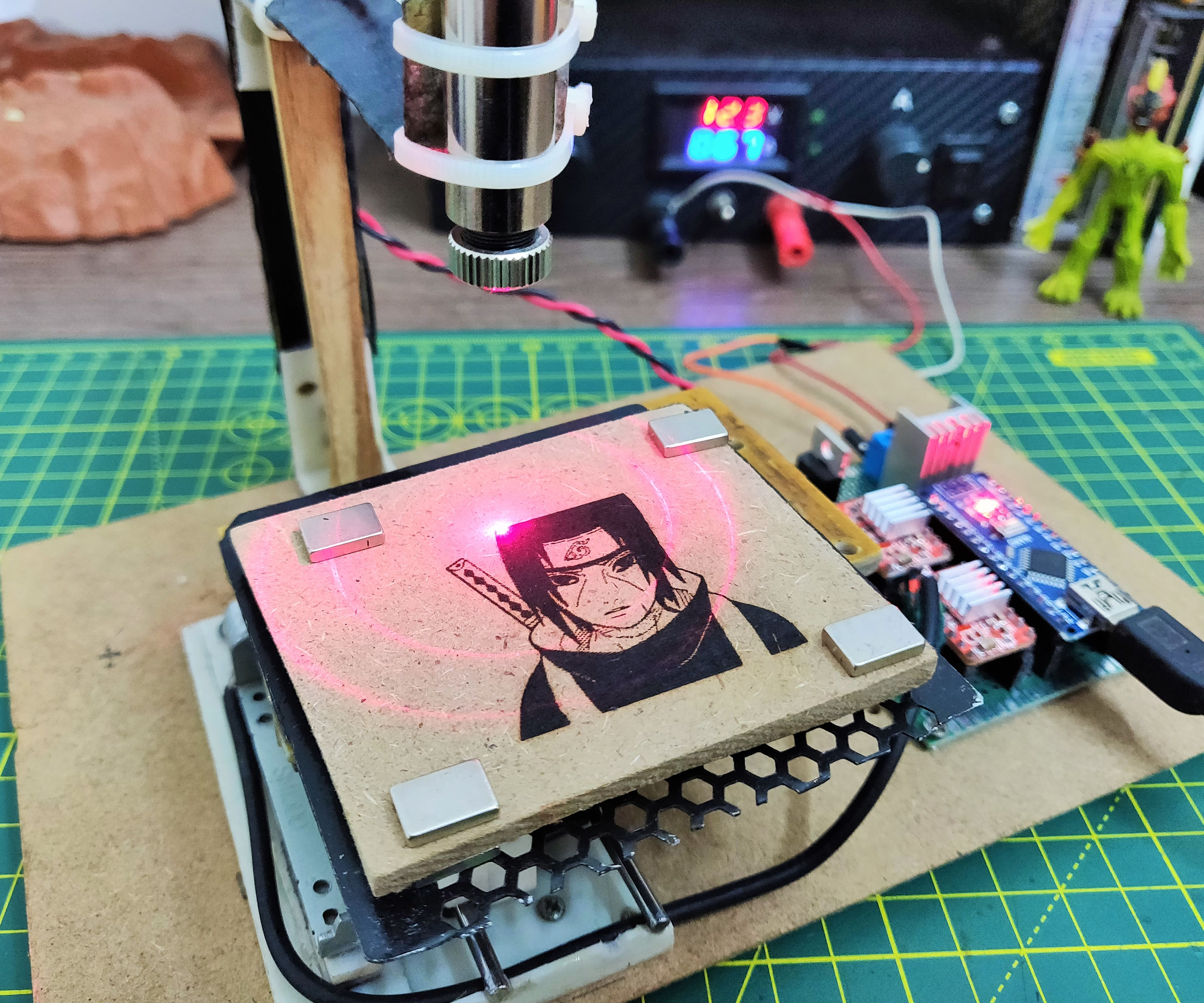 Mini CNC Laser Wood Engraver and Paper Cutter.