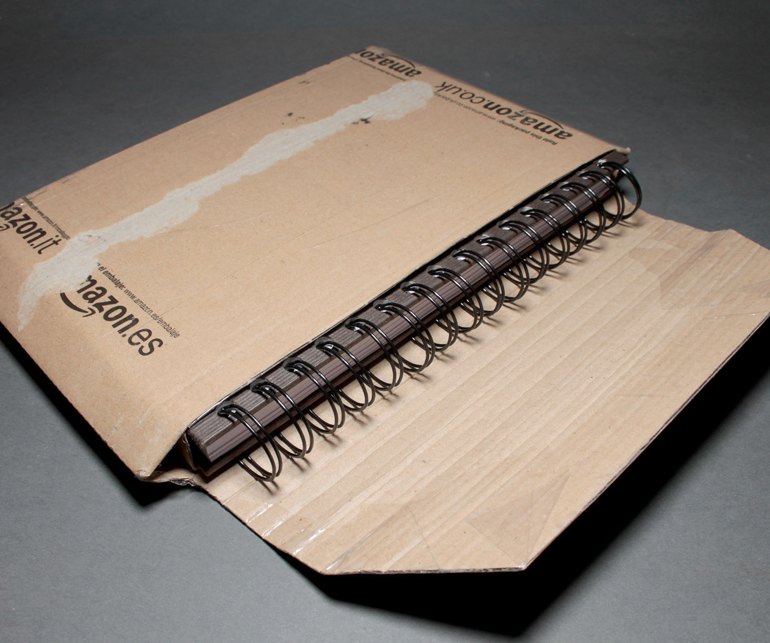 Protective cover for spiral book (or any other book) from amazon packaging (free, 10 min.)