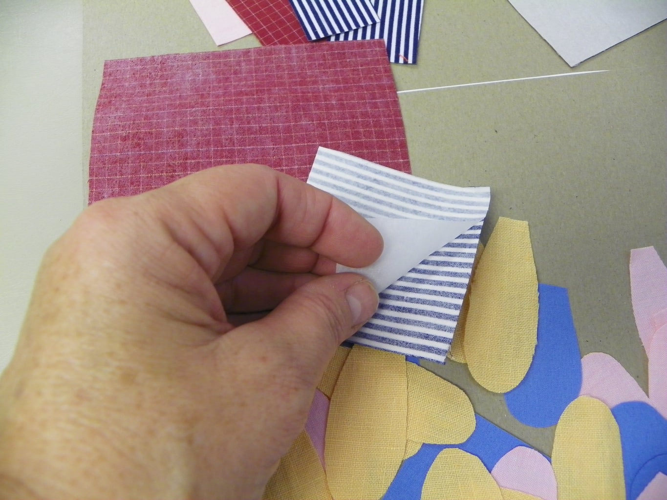 Peeling the Paper Off the Back of the Shapes
