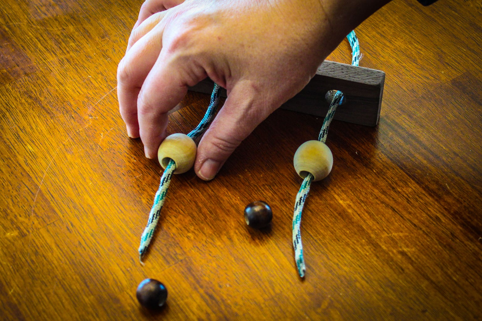 Push Rope Through Large Wood Beads