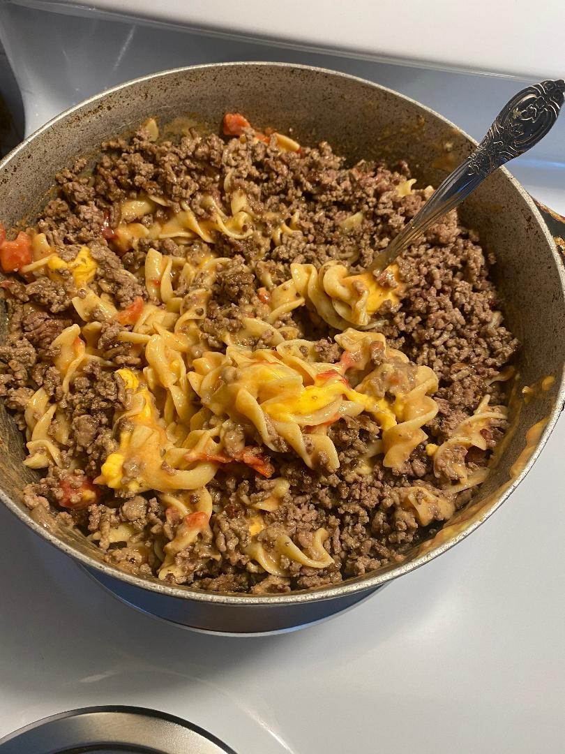 Step 6: Stir Cooked Ground Beef to Mixture. Cook on Low Heat for 20 Minutes. Stir Occasionally.