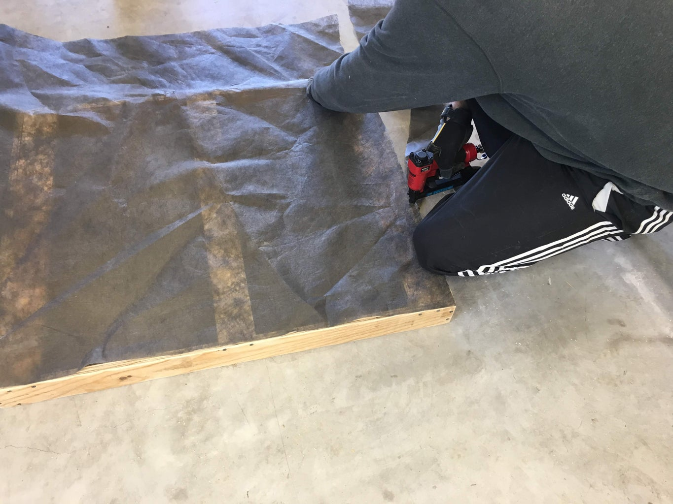 Sanding and Attaching the Landscaping Fabric