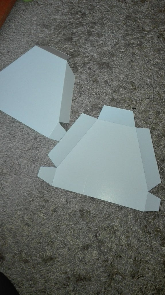 Folding the Cut Out Cardboard Pieces,and Glueing Them Together.