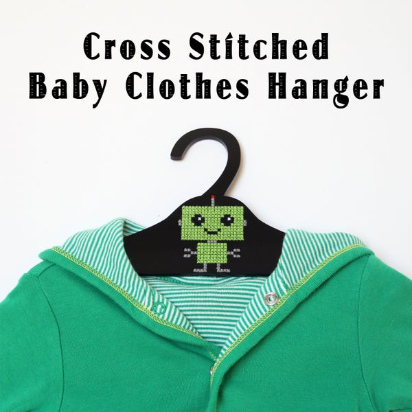 Cross Stitched Baby Clothes Hanger