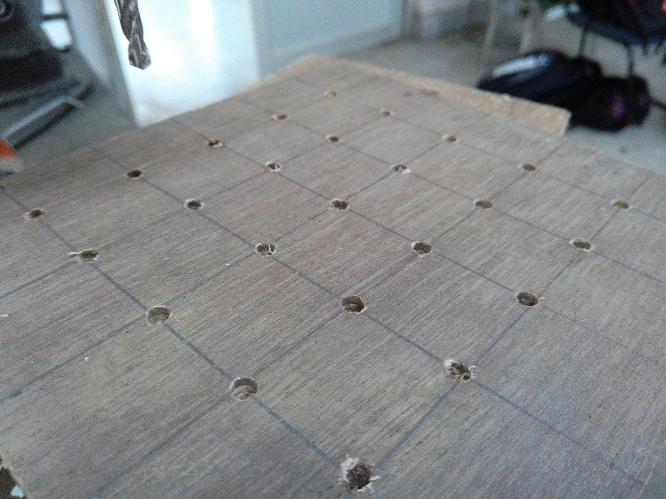 3. Making Holes on the Cut Out Square Pieces
