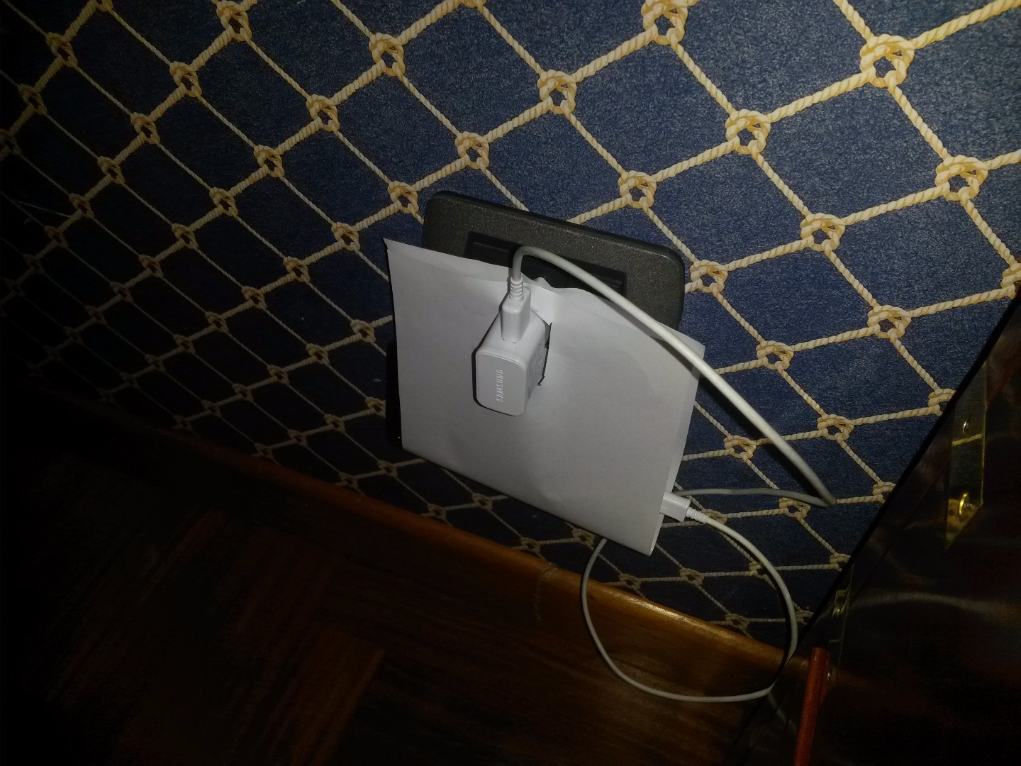 Phone Charger Holder With A Paper Sheet
