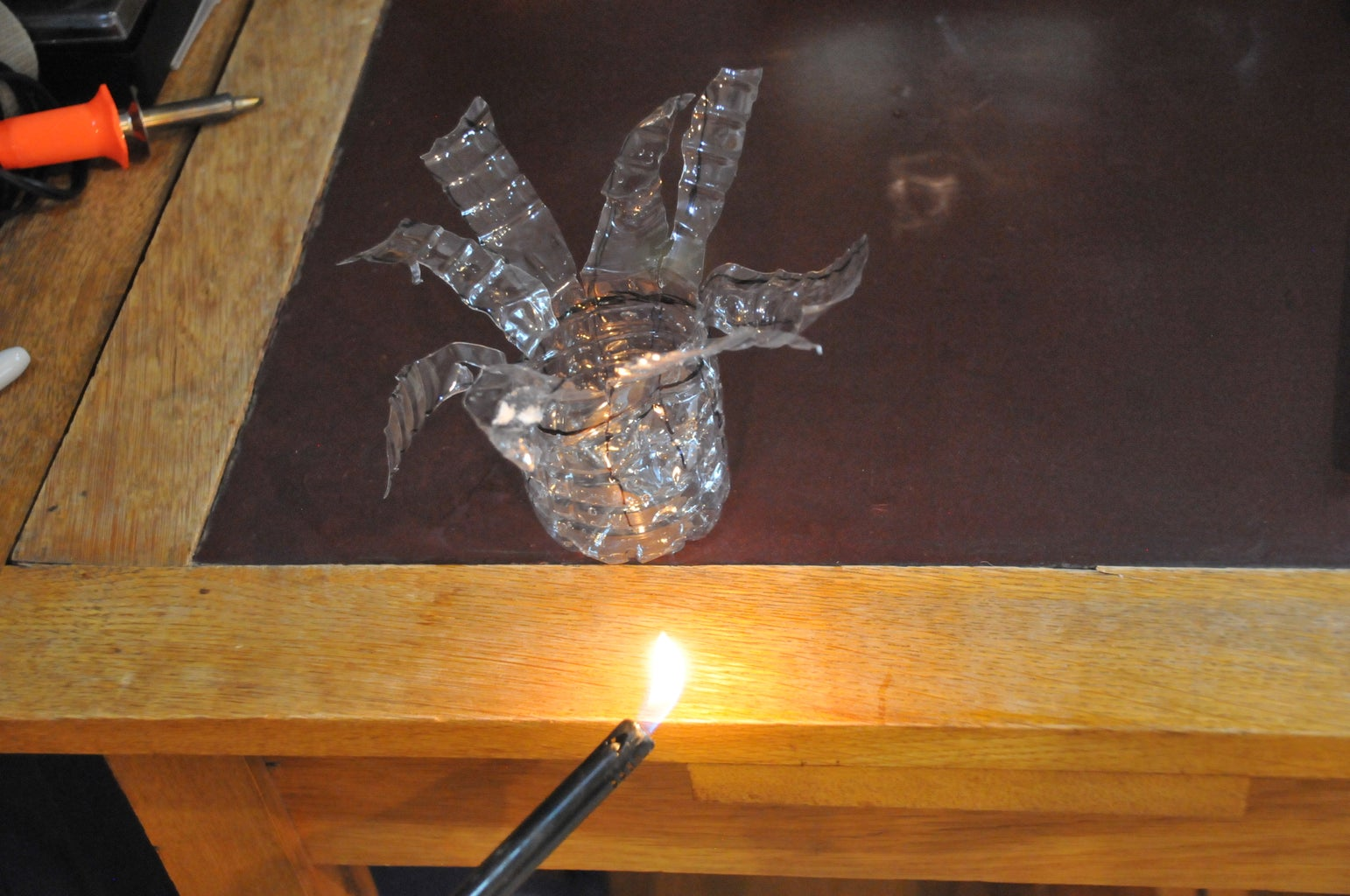 Step 3. If Your Flaps Won't Stay Down, Use a Lighter to Melt the Plastic So They Will Stay Down