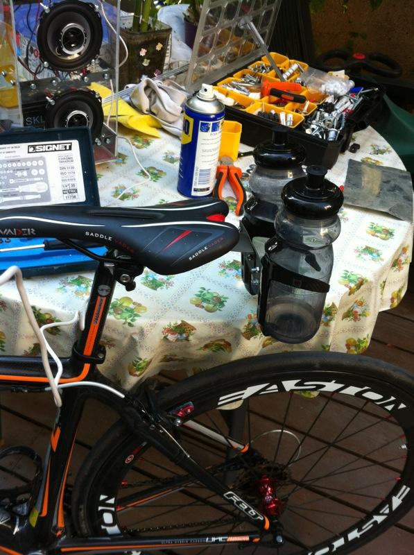 Rear cage for bottles for road bike