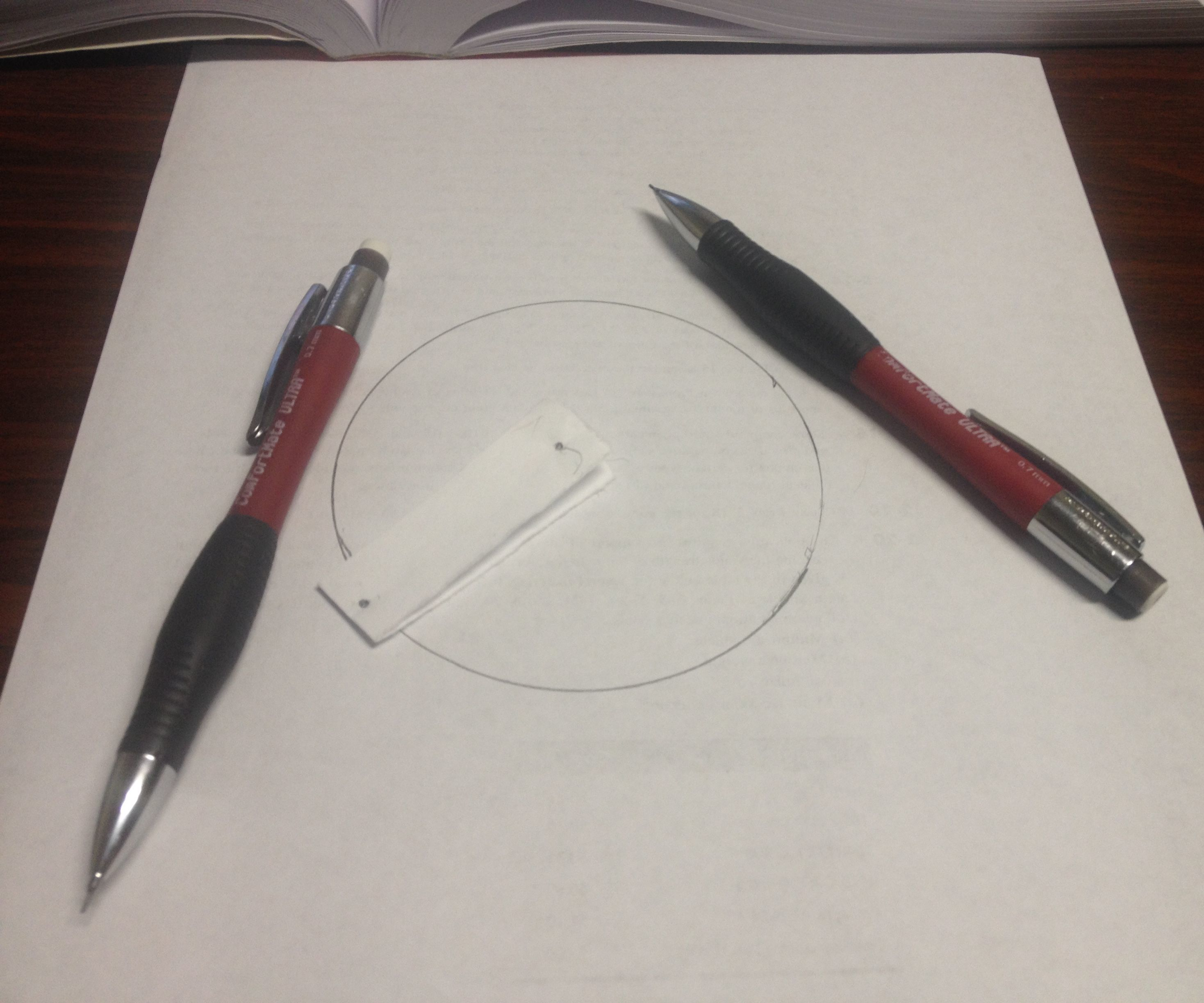 Draw a perfect circle with nothing more than paper and a pencil.