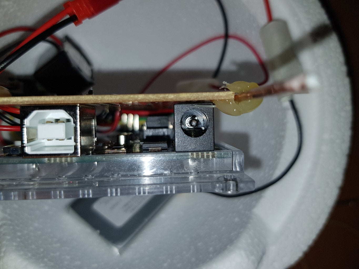 Step 4: Hot Glueing Metal Wire to Your PCB