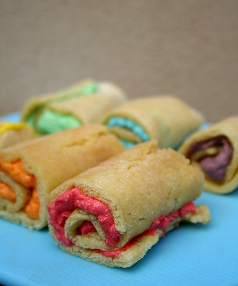 Make Little Rainbow-rritos From Cake Strips.