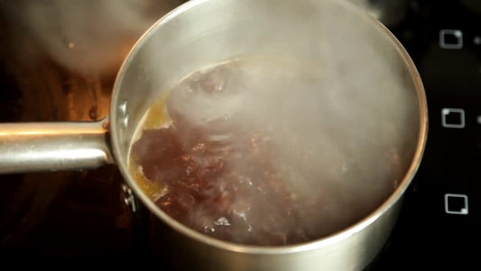 Place the Pot Over a High Heat and Add Half a Cup of Red Wine.