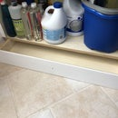 Shelving With Concealed Toe-Kick Compartment