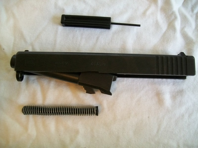 Remove Recoil Spring and Barrel