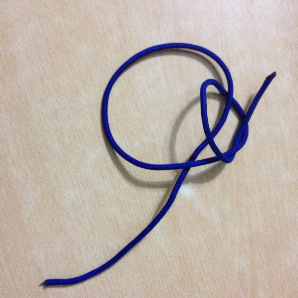 First Tie an Overhand Knot Leaving About 6 Cm (a Little Over 2 Inches)  End