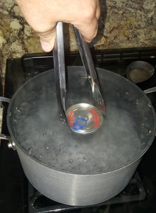 Remove Label and Place in to Pot of Boiling Water